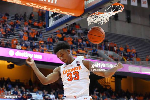 Elijah Hughes of the Syracuse Orange reacts to his dunk against the St Rose Golden Knights during the second half at the Carrier Dome on October 25...