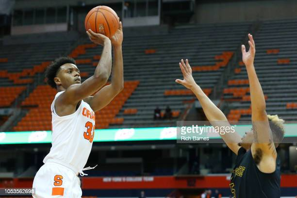 Elijah Hughes of the Syracuse Orange shoots the ball against the defense of Michael Wearne of the St Rose Golden Knights during the first half at the...