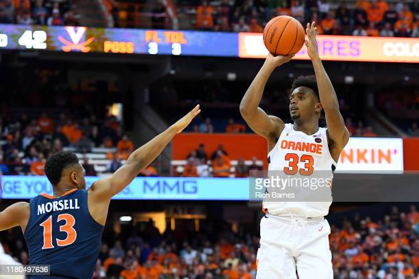 Elijah Hughes of the Syracuse Orange shoots the ball as Casey Morsell of the Virginia Cavaliers defends during the second half at the Carrier Dome on...