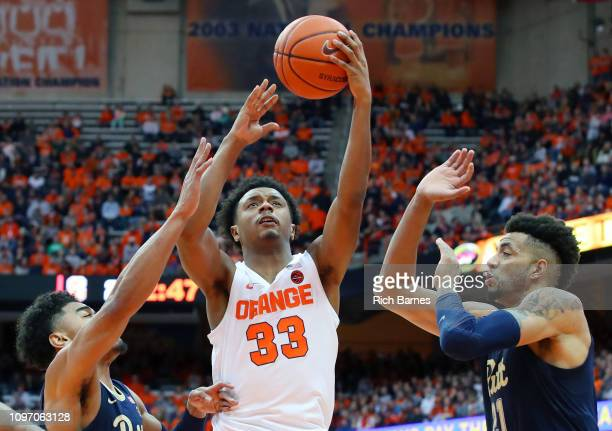 Elijah Hughes of the Syracuse Orange shoots the ball between Malik Ellison and Terrell Brown of the Pittsburgh Panthers during the first half at the...