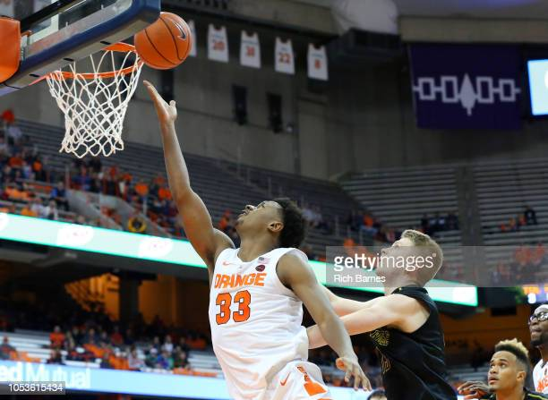 Elijah Hughes of the Syracuse Orange shoots the ball past Matt Cerutti of the St Rose Golden Knights during the second half at the Carrier Dome on...