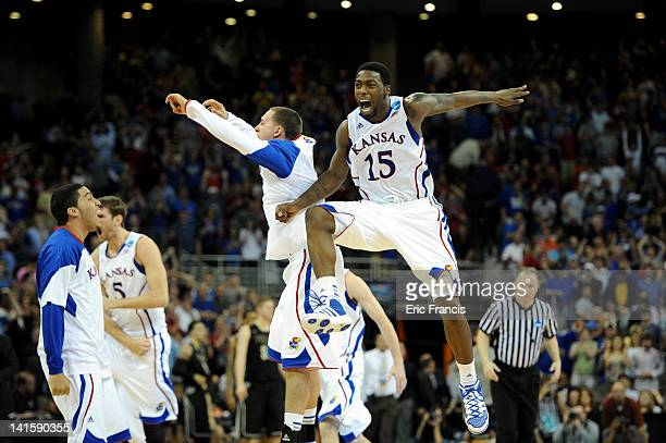 Elijah Johnson and Christian Garrett of the Kansas Jayhawks celebrate after they won 63-60 against the Purdue Boilermakers during the third round of...