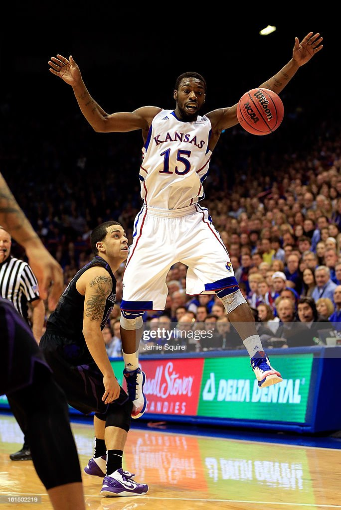 Elijah Johnson #15 of the Kansas Jayhawks blocks a pass by Angel Rodriguez #13 of the Kansas State Wildcats during the game at Allen Fieldhouse on February 11, 2013 in Lawrence, Kansas.