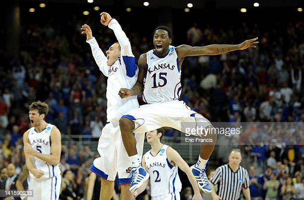 Elijah Johnson of the Kansas Jayhawks celebrates with teammates after they won 6360 against the Purdue Boilermakers during the third round of the...