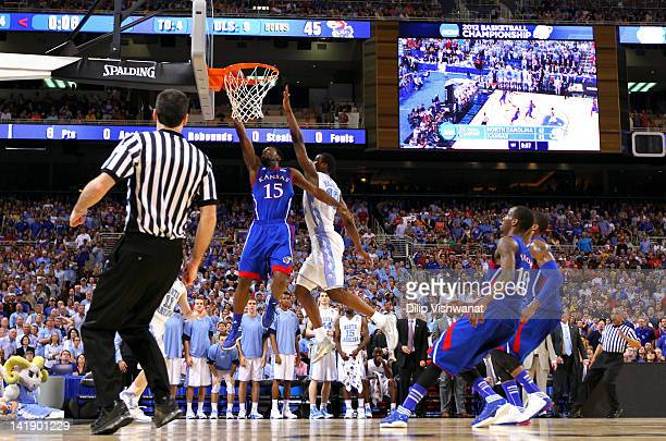 Elijah Johnson of the Kansas Jayhawks drives for a shot attempt in the first half against Harrison Barnes of the North Carolina Tar Heels during the...