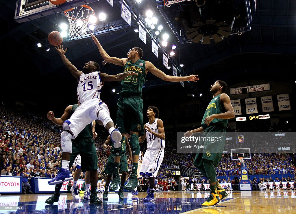 Elijah Johnson #15 of the Kansas Jayhawks drives inside as Isaiah Austin #21 of the Baylor Bears defends during the game at Allen Fieldhouse on January 14, 2013 in Lawrence, Kansas.