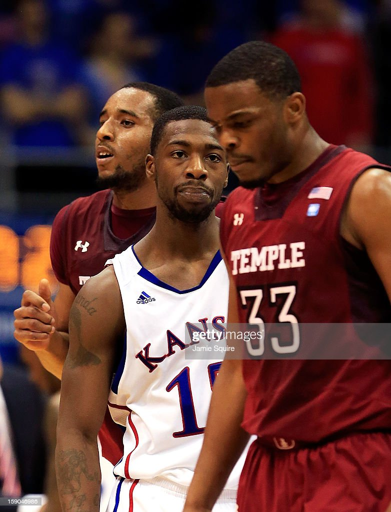 Elijah Johnson #15 of the Kansas Jayhawks glares at Scootie Randall #33 of the Temple Owls during the game at Allen Fieldhouse on January 6, 2013 in Lawrence, Kansas.