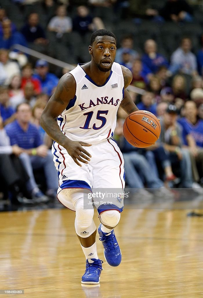 Elijah Johnson #15 of the Kansas Jayhawks in action during the CBE Hall of Fame Classic against the Washington State Cougars at the Sprint Center on November 19, 2012 in Kansas City, Missouri.