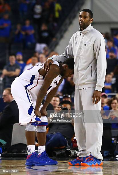 Elijah Johnson of the Kansas Jayhawks is dejected after their 87 to 85 loss to the Michigan Wolverines in overtime during the South Regional...
