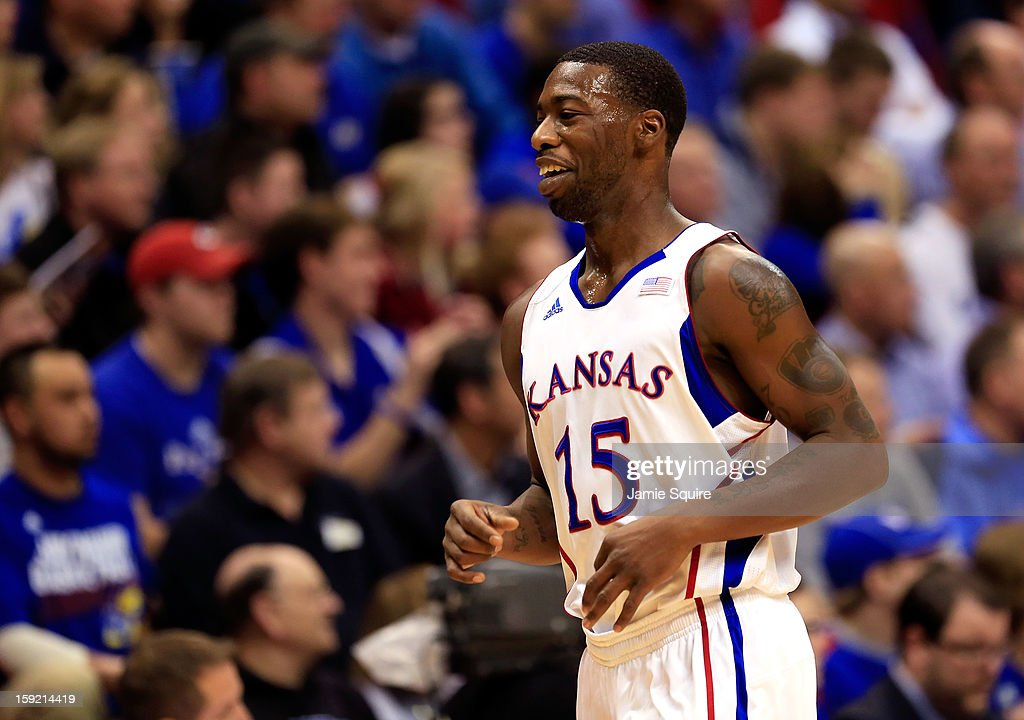 Elijah Johnson #15 of the Kansas Jayhawks smiles during the game against the Iowa State Cyclones at Allen Fieldhouse on January 9, 2013 in Lawrence, Kansas.