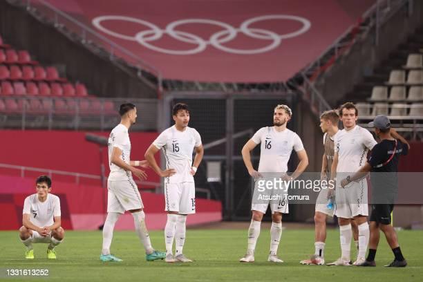 Elijah Just, Dane Ingham, Gianni Stensness and Joe Bell of Team New Zealand look dejected following defeat in the Men's Quarter Final match between...