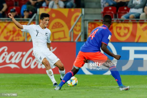 Elijah Just of New Zealand and Anderson Arroyo of Colombia battle for the ball during the 2019 FIFA U20 World Cup Round of 16 match between Colombia...