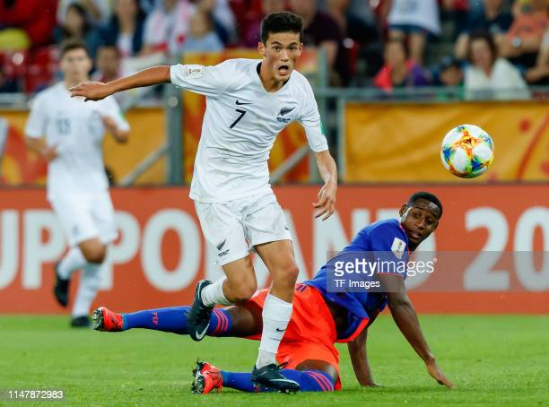 Elijah Just of New Zealand and Andres Reyes of Colombia battle for the ball during the 2019 FIFA U20 World Cup Round of 16 match between Colombia and...