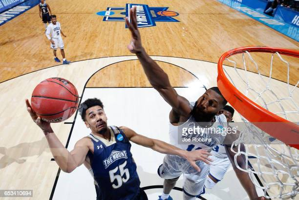 Elijah Long of the Mount St Mary's Mountaineers drives to the basket against Michael Zeno of the New Orleans Privateers in the second half during the...