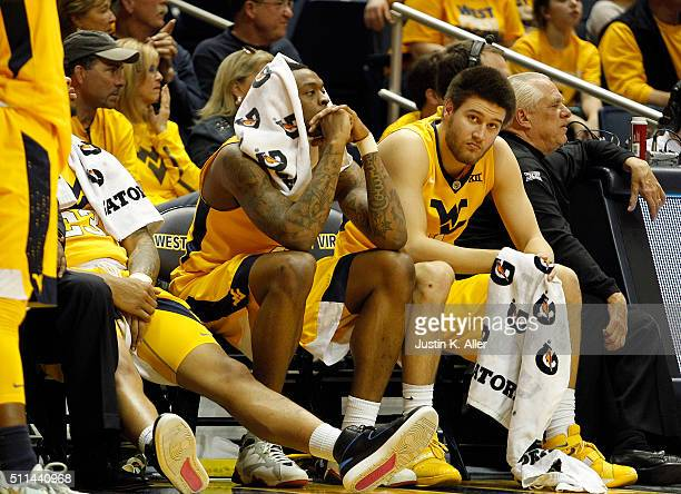Elijah Macon and Nathan Adrian of the West Virginia Mountaineers look on from the bench during the game against the Oklahoma Sooners at the WVU...