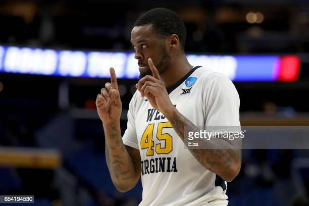 Elijah Macon of the West Virginia Mountaineers celebrates after defeating the Bucknell Bison with a score of 86 to 80 during the first round of the...