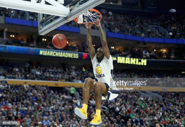 Elijah Macon of the West Virginia Mountaineers dunks the ball against the Notre Dame Fighting Irish during the second round of the 2017 NCAA Men's...