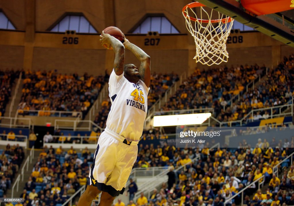 Elijah Macon #45 of the West Virginia Mountaineers dunks the basketball against the Oklahoma State Cowboys at the WVU Coliseum on February 4, 2017 in Morgantown, West Virginia.