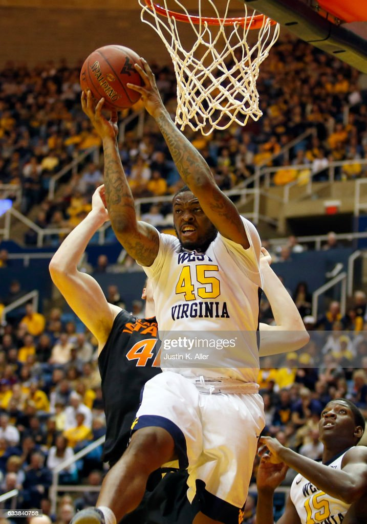 Elijah Macon #45 of the West Virginia Mountaineers pulls down a rebound against the Oklahoma State Cowboys at the WVU Coliseum on February 4, 2017 in Morgantown, West Virginia.