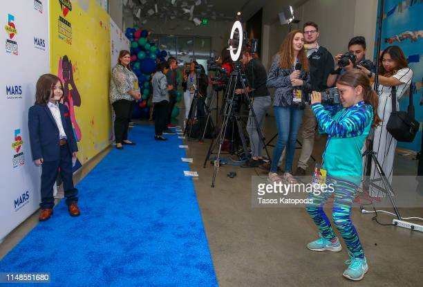 Elijah Maximus of Carol of The Bells walks the blue carpet the filmmaker awards ceremony at the 5th Annual Bentonville Film Festival on May 11 2019...