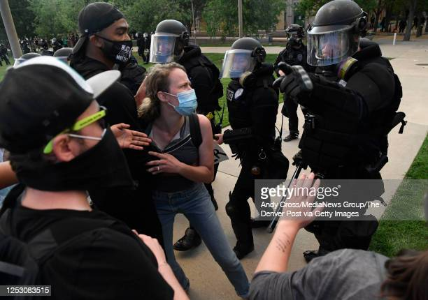 Elijah McClain protesters clash with Aurora Police officers with batons at the Aurora Municipal Center June 27 2020 Elijah McClain died August 30...