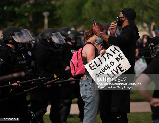 Elijah McClain protesters close to the Aurora place line at the Aurora Municipal Center June 27 2020 Elijah McClain died August 30 2019 several days...