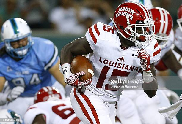 Elijah McGuire of the LouisianaLafayette Ragin Cajuns runs with the ball during the first half of a game against the Tulane Green Wave at Yulman...