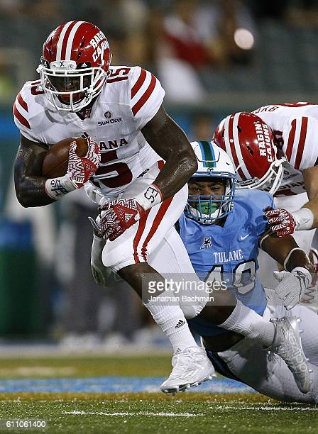 Elijah McGuire of the LouisianaLafayette Ragin Cajuns runs with the ball during a game at Yulman Stadium on September 24 2016 in New Orleans Louisiana
