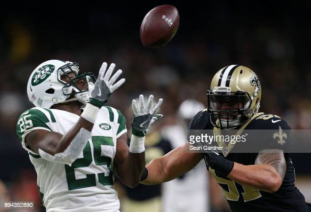 Elijah McGuire of the New Orleans Saints catches the ball as middle linebacker Manti Te'o of the New Orleans Saints defends during the second half of...