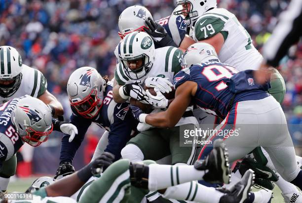 Elijah McGuire of the New York Jets carries the ball during the first half against the New England Patriots at Gillette Stadium on December 31 2017...