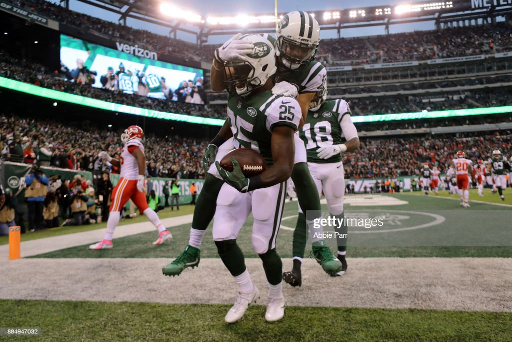 Elijah McGuire of the New York Jets celebrates with Jermaine Kearse #10 of the New York Jets after scoring a touchdown in the fourth quarter during their game at MetLife Stadium on December 3, 2017 in East Rutherford, New Jersey.
