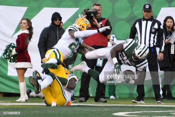 Elijah McGuire of the New York Jets dives for a touchdown against the Green Bay Packers during the third quarter at MetLife Stadium on December 23...