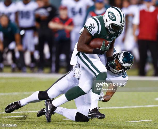 Elijah McGuire of the New York Jets drives into Corey Clement of the Philadelphia Eagles during their preseason game at MetLife Stadium on August 31...