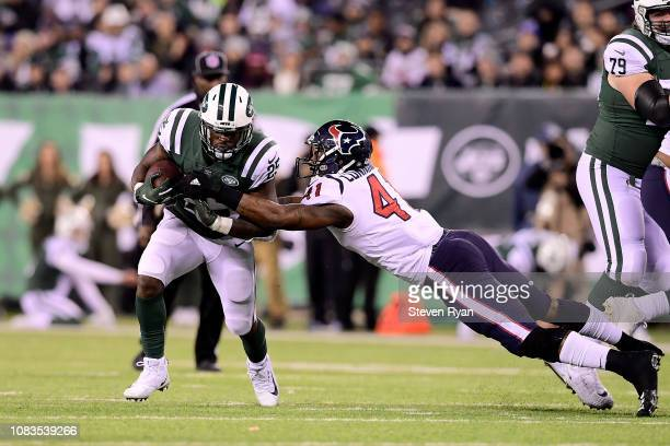 d1246478aaa Elijah McGuire of the New York Jets looks to avoid the tackle attempt from  Zach Cunningham