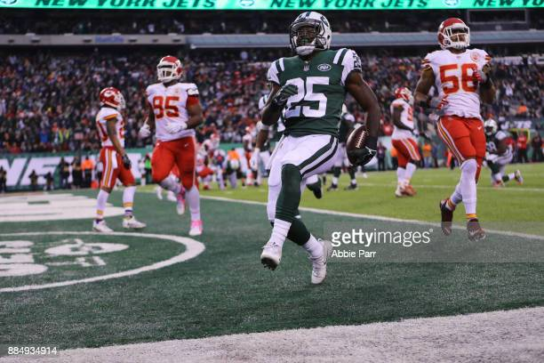 Elijah McGuire of the New York Jets reacts after scoring a touchdown in the fourth quarter during their game at MetLife Stadium on December 3 2017 in...