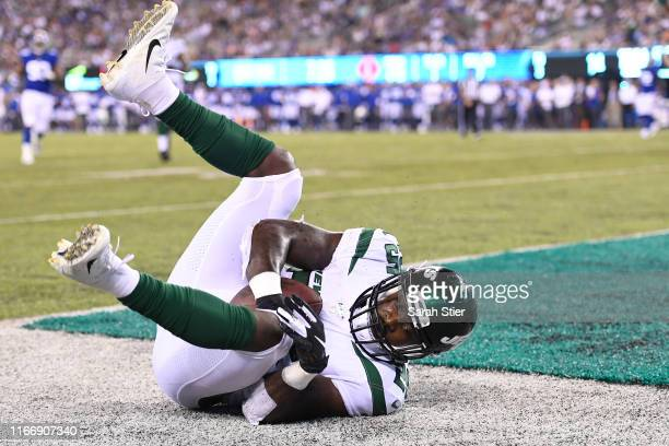 Elijah McGuire of the New York Jets rolls in the end zone after scoring a touchdown during the second quarter of a preseason game against the New...