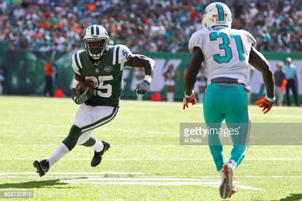 Elijah McGuire of the New York Jets runs against Michael Thomas of the Miami Dolphins during the second half of an NFL game at MetLife Stadium on...