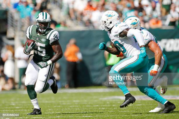 Elijah McGuire of the New York Jets runs the ball against the Miami Dolphins during the first half of an NFL game at MetLife Stadium on September 24...