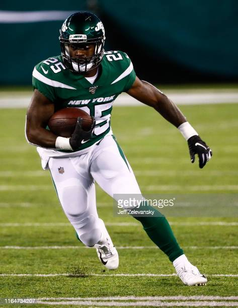 Elijah McGuire of the New York Jets runs the ball during the preseason game against the Philadelphia Eagles at MetLife Stadium on August 29 2019 in...