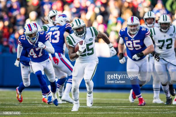 Elijah McGuire of the New York Jets runs with the ball during the third quarter against the Buffalo Bills at New Era Field on December 9 2018 in...