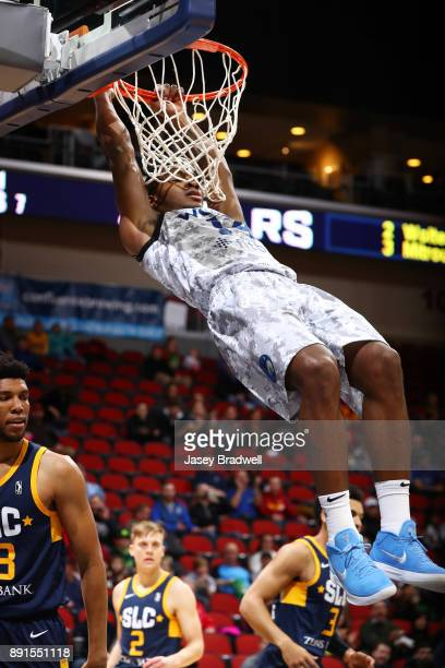 Elijah Millsap of the Iowa Wolves dunks past Tony Bradley of the Salt Lake City Stars in an NBA GLeague game on December 8 2017 at the Wells Fargo...