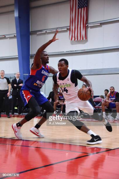 Elijah Millsap of the Iowa Wolves handles the ball against the Grand Rapids Drive NBA G League Showcase Game 20 between the Grand Rapids Drive and...