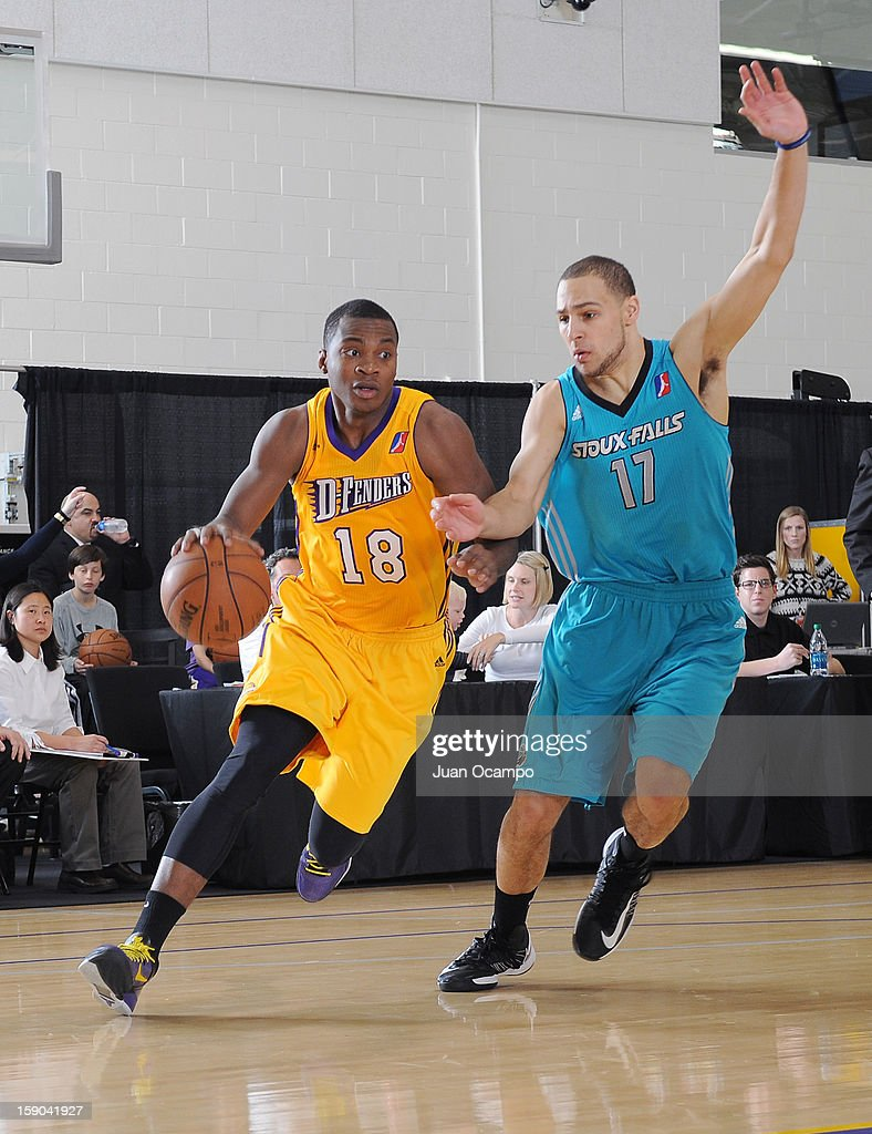 Elijah Millsap #18 of the Los Angeles D-Fenders drives to the basket against Mychel Thompson #17 of the Sioux Falls Skyforce on January 5, 2013 at Toyota Sports Center in El Segundo, California.