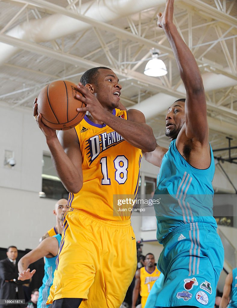 Elijah Millsap #18 of the Los Angeles D-Fenders looks to make a pass against Dexter Pittman #50 of the Sioux Falls Skyforce on January 5, 2013 at Toyota Sports Center in El Segundo, California.