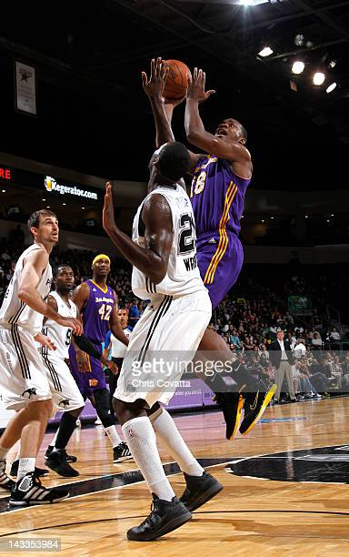Elijah Millsap of the Los Angeles DFenders shoots over Julian Wright of the Austin Toros in game one of the 2012 NBA Development League Finals...