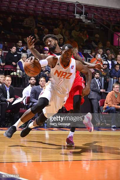 Elijah Millsap of the Northern Arizona Suns drives against Chris Walker of the Rio Grande Valley Vipers on December 9 at Prescott Valley Event Center...