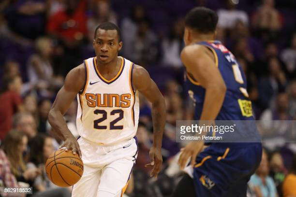 Elijah Millsap of the Phoenix Suns handles the ball during the second half of the NBA preseason game against the Brisbane Bullets at Talking Stick...