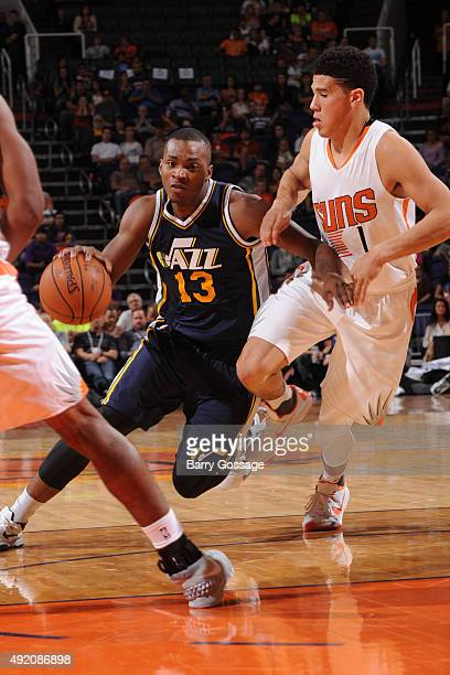 Elijah Millsap of the Utah Jazz drives against Devin Booker of the Phoenix Suns on October 9 at Talking Stick Resort Arena in Phoenix Arizona NOTE TO...