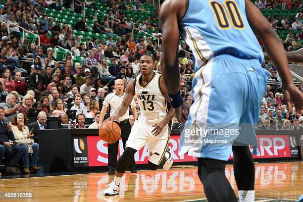 Elijah Millsap of the Utah Jazz drives to the basket against the Denver Nuggets on October 22 2015 at EnergySolutions Arena in Salt Lake City Utah...