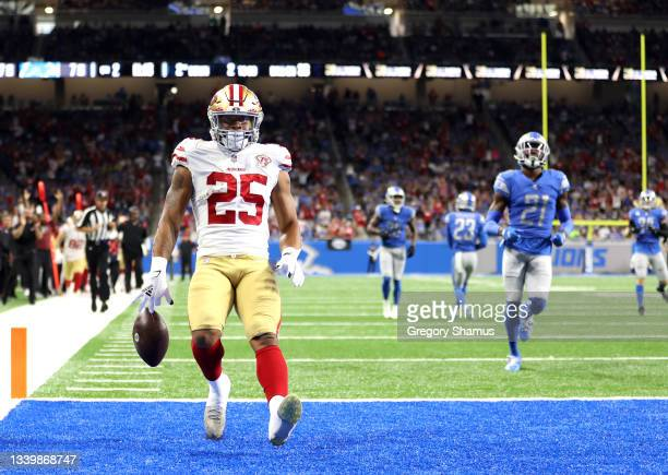 Elijah Mitchell of the San Francisco 49ers celebrates his 38-yard rushing touchdown against the Detroit Lions during the second quarter at Ford Field...